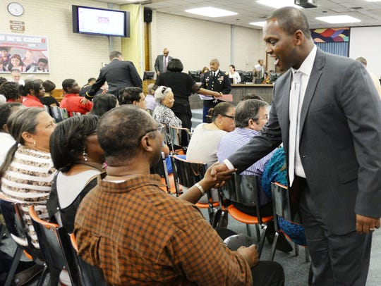 Superintendent Lamar Goree says hello to people at a Caddo School Board meeting Tuesday afternoon. The school board now can decide whether to grant industrial tax exemptions.