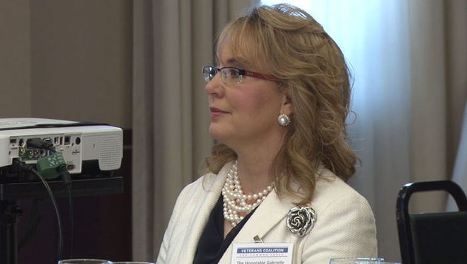 """Former Rep. Gabby Giffords said it """"takes courage"""" to stop gun violence/ Giffords, severely wounded in a 2011 shooting, was speaking at a vets' gun-control group."""