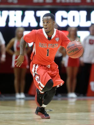 Ball State's Zavier Turner (1) brings the ball up court in the first half during an NCAA college basketball game against Utah Friday, Nov. 14, 2014, in Salt Lake City. (AP Photo/Rick Bowmer)