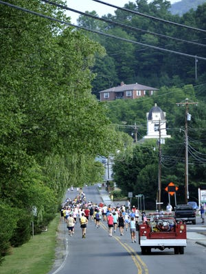 Runners take off at the start of the annual Rhododendron 10K in Bakersville in a past race. The 38th annual race is Saturday, June 20, in Bakersville, Mitchell County.