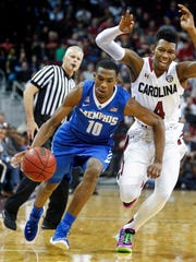 December 30, 2015 - University of Memphis guard Jeremiah Martin (right) drives by University of South Carolina guard Jamall Gregory (left) during first half action in Columbia, S.C.