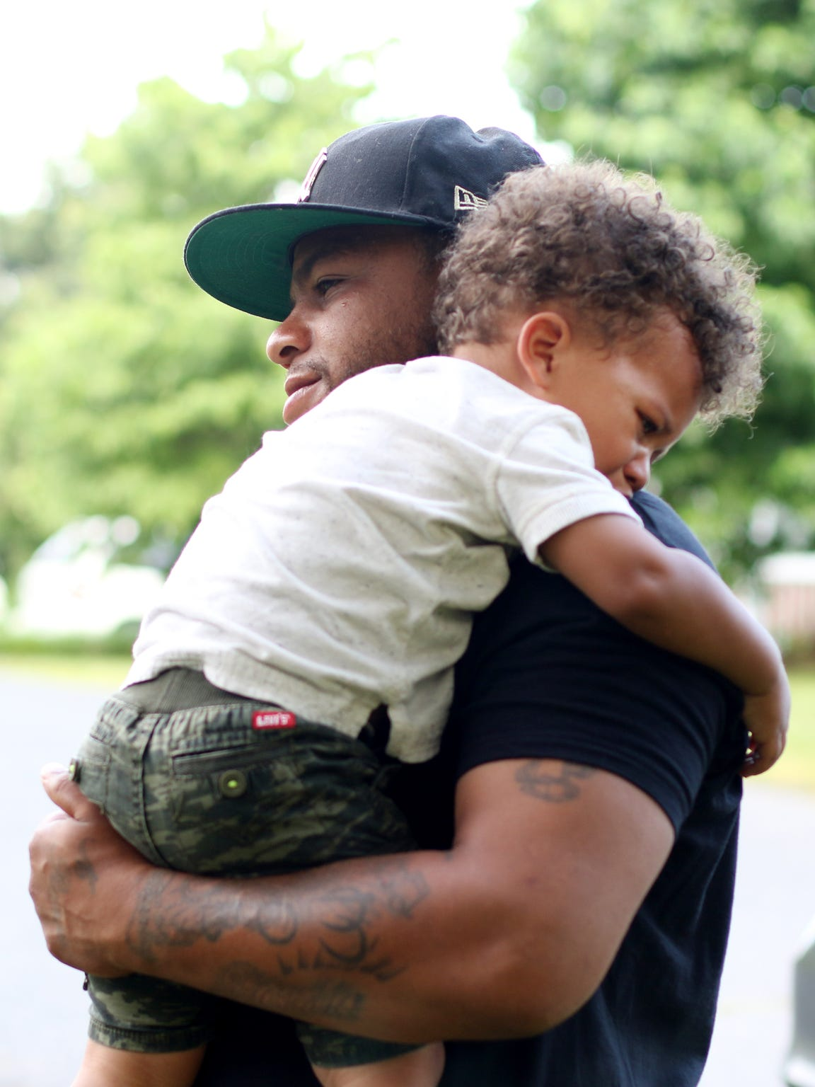 "Terry ""Buck"" Davis holds his son, Jasiah. The family"