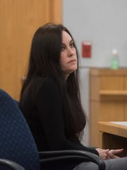 Ashley McArthur listens to testimony during bond revocation hearing before Circuit Judge Jan Shackelford Monday, April 23, 2018. McArthur is accused of killing private detective Taylor Wright and burying her on a family member's property.