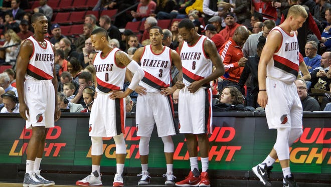 The Trail Blazers starting five, from left, forward Noah Vonleh, guard Damian Lillard, guard C.J. McCollum, forward Al-Farouq Aminu and center Mason Plumlee wait to come back on the floor after a time out against the Dallas Mavericks during the first half of an NBA basketball game in Portland, Ore., Tuesday, Dec. 1, 2015.