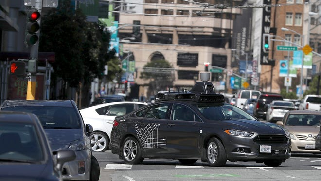 An Uber self-driving car drives down 5th Street on March 28, 2017 in San Francisco, CA.