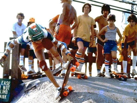 A young skater does a trick during the early days of