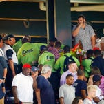 Emergency medical personnel carry an injured fan from the stands at Turner Field during a baseball game between Atlanta Braves and New York Yankees Saturday, Aug. 29, 2015, in Atlanta. A fan has been given emergency medical treatment and been taken to a hospital after falling from the upper deck into the lower-level stands at Turner Field during a game between the New York Yankees and Atlanta Braves. (AP Photo/John Bazemore)