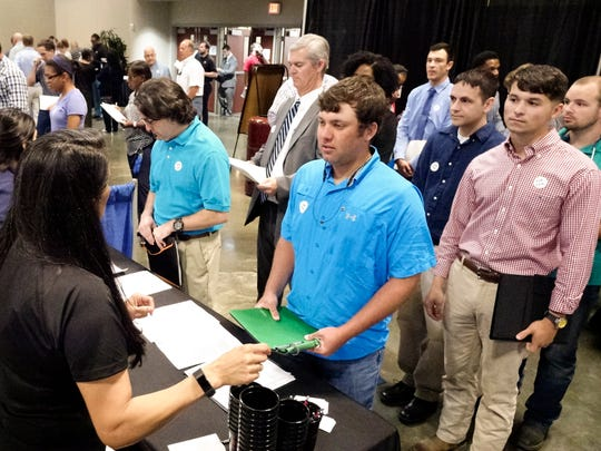 Jobseekers line up to speed to a potential employer during the Lafayette Economic Development Authority (LEDA) Job Fair at the Cajundome Convention Center Tuesday, May 9, 2017.