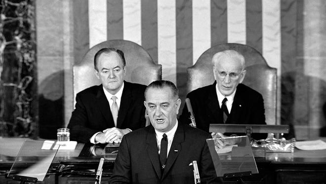 In this March 15, 1965 file photo, U.S. President Lyndon B. Johnson addresses a joint session of Congress in Washington.