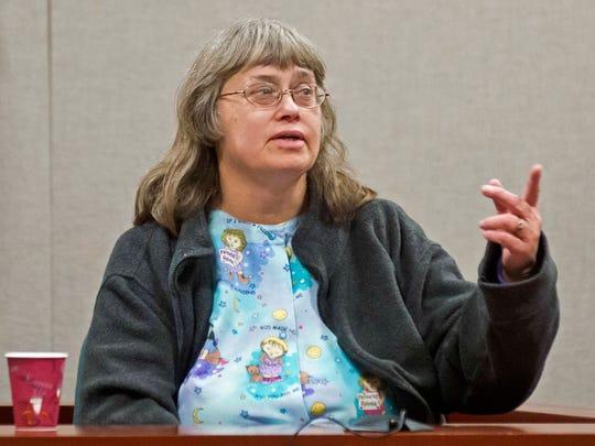 Allen Prue's mother, Donna Prue, points him out at