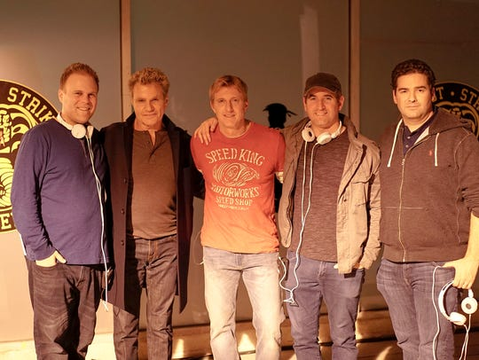 "Martin Kove (second from left) poses on the ""Cobra"