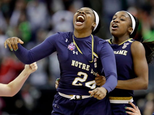 Notre Dame's Arike Ogunbowale is congratulated by teammate Jackie Young after beating Mississippi State, 61-58, for the NCAA championship.