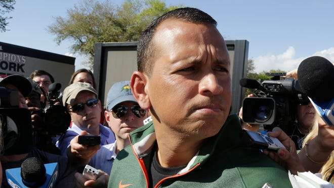 Alex Rodriguez talks with the media following a workout Monday in Tampa, Fla.