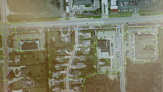 A map of the affected area where a sinkhole at 15 Mile Road and Eberlein occurred is shown during a meeting hosted by the City of Fraser to answer resident's questions and discuss upcoming fixes on Monday December 26, 2016.