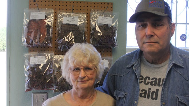 Gail Meadows (left), and her husband Dean own and operate Dean's Jerky, March 28, 2018 at the shop on Standpipe Road.