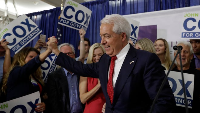 Republican gubernatorial candidate John Cox greets a supporter during a San Diego Republican election party Tuesday, June 5, 2018, in San Diego.