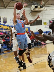 South Gibson's Nathan Hicks goes up for a layup during