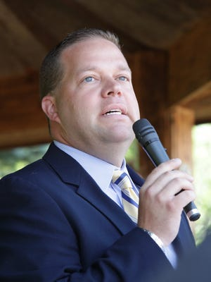 Rochester Hills Mayor Bryan Barnett speaks during a press conference in Rochester Hills in 2012.