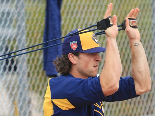 Brewers pitcher Taylor Williams stretches prior to