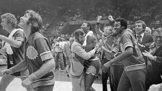 Phoenix Suns' coach John MacLeod hugs Curtis Perry and as his Suns defeated the Golden State Warriors, 94-86 to win the NBA Western Conference title in Oakland, Calif., May 16, 1976. Phoenix will face the winner of the Boston-Cleveland series for the NBA championship.