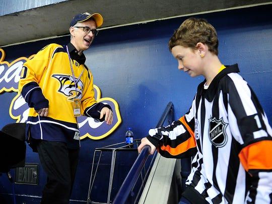 "Predators organist ""Krazy Kyle"" Hankins greets Elizabeth Cronin during a game against the Winnipeg Jets at Bridgestone Arena on Nov. 15, 2014."