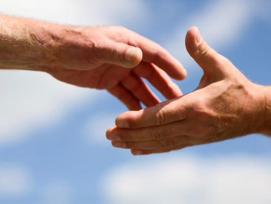 636758128058819960-helping-hands.jpg