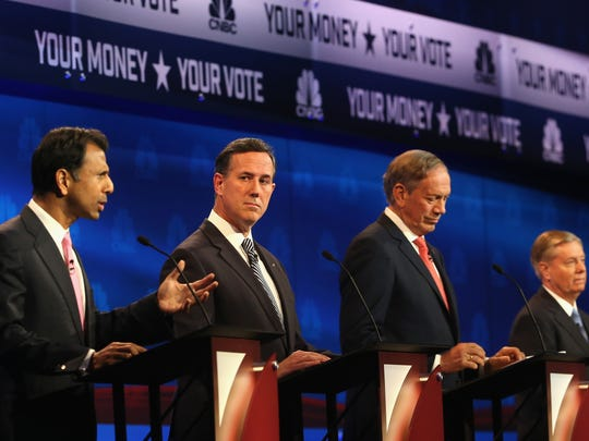 Presidential candidates Louisiana Governor Bobby Jindal (L-R), Rick Santorum, George Pataki, and Sen. Lindsey Graham (R-SC) take part in the CNBC Republican Presidential Debate at University of Colorado's Coors Events Center October 28, 2015 in Boulder, Colorado.