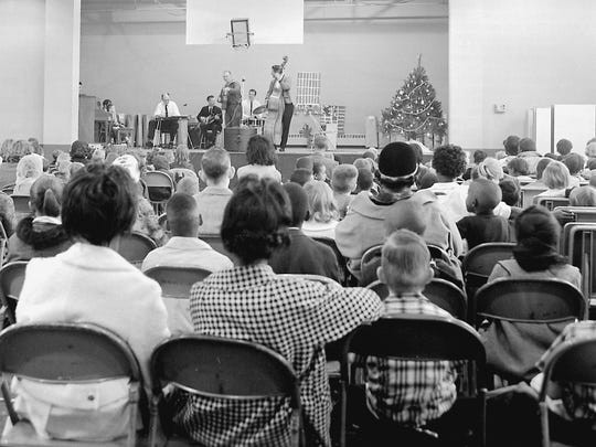 Entertainers take the stage at the annual Goodfellow Christmas Party in 1965. The event has long been a community-wide effort that provides Christmas cheer for underprivileged children. (Photo from Gleaner files)