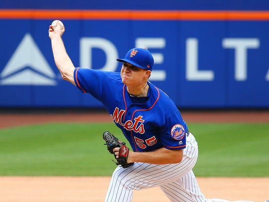 New York Mets starting pitcher Corey Oswalt (55) pitches