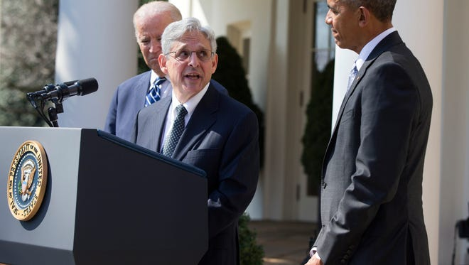Federal appeals court judge Merrick Garland, center, speaks as President Barack Obama, right, and Vice President Joe Biden listen after he was introduced as Obama's nominee for the Supreme Court during an announcement in the Rose Garden of the White House in Washington. (AP Photo/Evan Vucci)