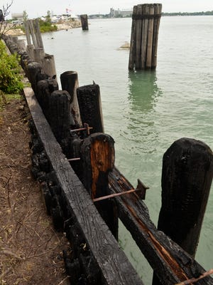 Fire-damaged wood near the ferry dock along the Blue Water River Walk. The Port Huron Fire Department responded to the scene at 3:10 a.m. to the fire at the former ferry dock, just south of Vantage Point along the St. Clair River.
