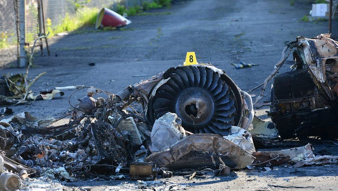 Two days after the plane crash in Carlstadt, a charred trail of buildings and cars was still on the ground early Wednesday. The cleanup began that day.