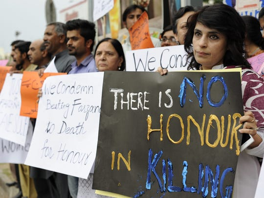 Civil society activists carry placards during a protest