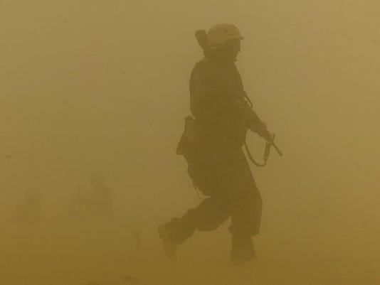 -APCBrd_06-02-2014_Crescent_1_B002~~2014~06~01~IMG_A05_DUST_STORM_IRAQ__1_1_.jpg