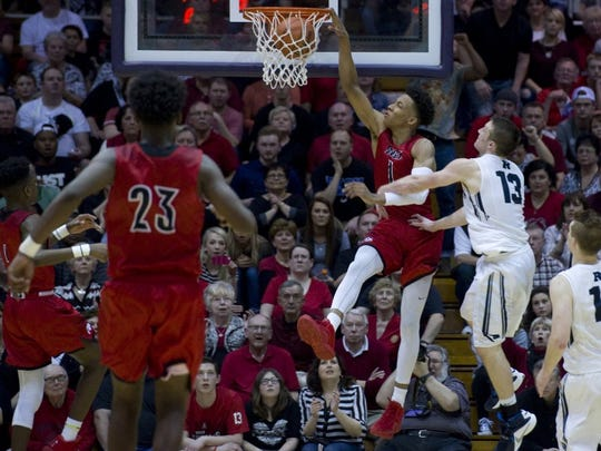 COURIER PRESS New Albany's Romeo Langford (1) slams