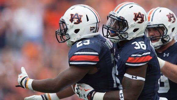 Auburn Tigers running back Peyton Barber (25) celebrates