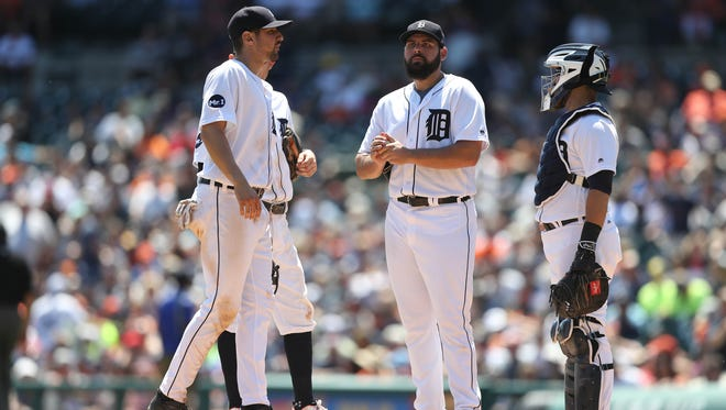 (From left) Tigers third baseman Nick Castellanos, pitcher Michael Fulmer and catcher Alex Avila wait for Brad Ausmus on the mound in the fifth inning of the Tigers' 11-4 loss Thursday at Comerica Park.