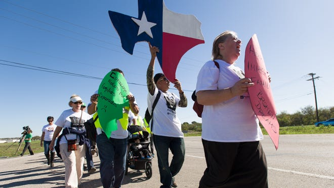 Felix Enrique Jiminez (center) joins other marchers in The Pilgrimage of Immigrant Families. The three day march organized by the Workers Defense Project, took the marchers from the Hutto Immigrant Detention Facility in Taylor, Texas, to the governor's mansion in Austin. The march was organized  to protest Texas Gov. Greg Abbot's opposition to President Obama's executive orders on immigration.