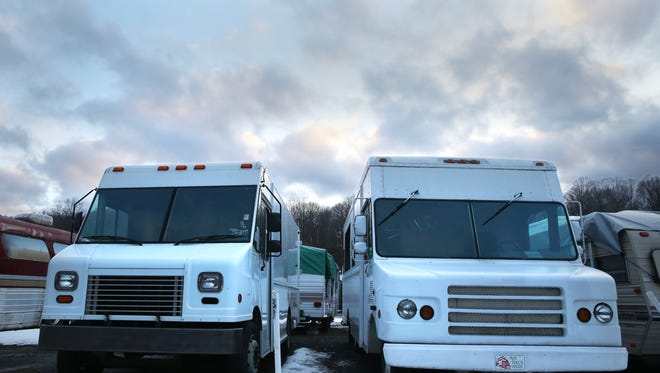 Food trucks that were not completed by M Design were found in a storage facility in Penfield.