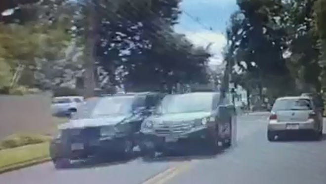 A Mansfield woman was ticketed after nearly hitting three cars while trying to stop someone involved in a road rage incident, Hackettstown Police said.