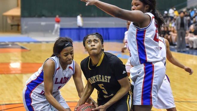 Northeast Jones' Gabrielle Bunch tries to go up for a shot as two Byhalia players defend. Bunch scored 25 points, but Byhalia won 74-62.