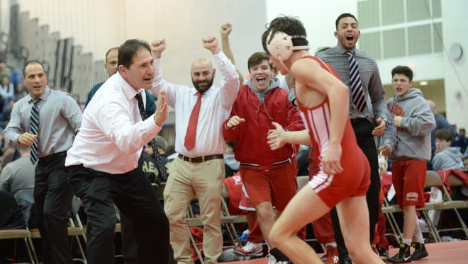 Paulsboro wrestling coach Paul Morina congratulates Georgio Mazzeo after his win in the 113-pound bout Sunday clinched the Group 1 state title against Emerson/Park Ridge in Toms River.