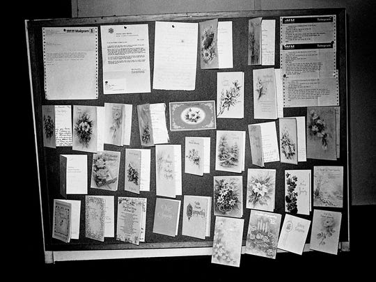 A bulletin board backstage at the Grand Ole Opry House Nov. 16, 1973 displays sympathy cards and messages sent as a result of the deaths of Opry member David (Stringbean) Akeman and his wife, Estelle.