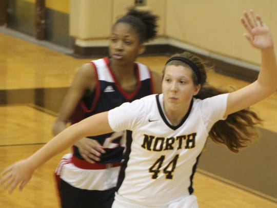 North Farmington senior center Sam Cherney (44) led her team's offense with yet another double-double (11 points, 10 rebounds).