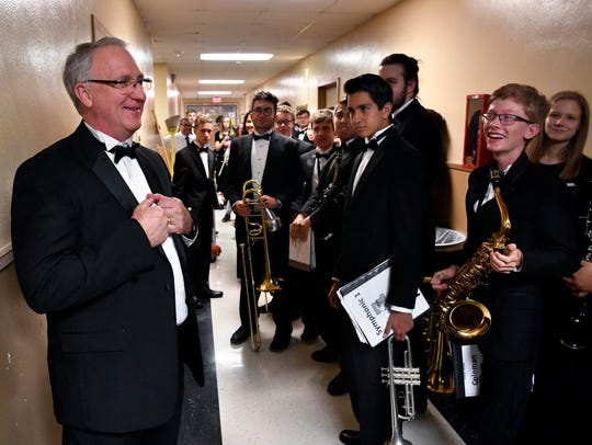 Band director Paul Walker speaks to the honor band members in a hallway outside the Abilene High School auditorium before their performance during Tuesday night's spring concert.