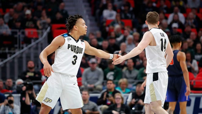 Mar 16, 2018; Detroit, MI, USA; Purdue Boilermakers guard Carsen Edwards (3) receives congratulations from guard Ryan Cline (14) in the first half against the Cal State Fullerton Titans in the first round of the 2018 NCAA Tournament at Little Caesars Arena. Mandatory Credit: Rick Osentoski-USA TODAY Sports