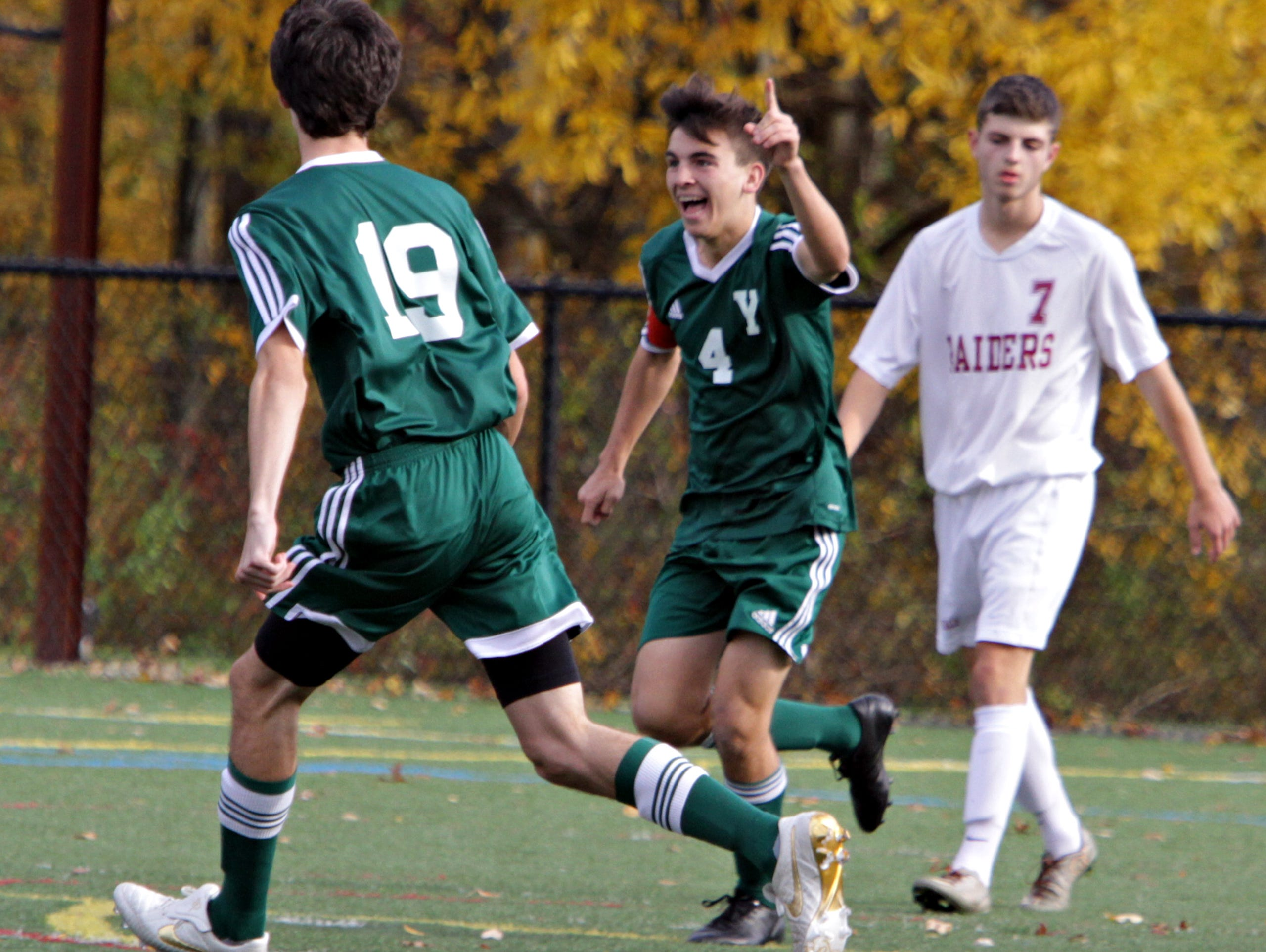 Yorktown celebrates their first goal against Scarsdale during their Class AA boys soccer semifinal at Purchase College Oct. 29, 2105.