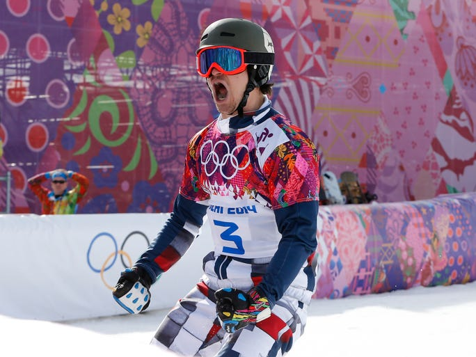 Vic Wild (RUS) celebrates after crossing the finish line ahead of Benjamin Karl in the men's parallel slalom semifinals. Wild went on to win gold.