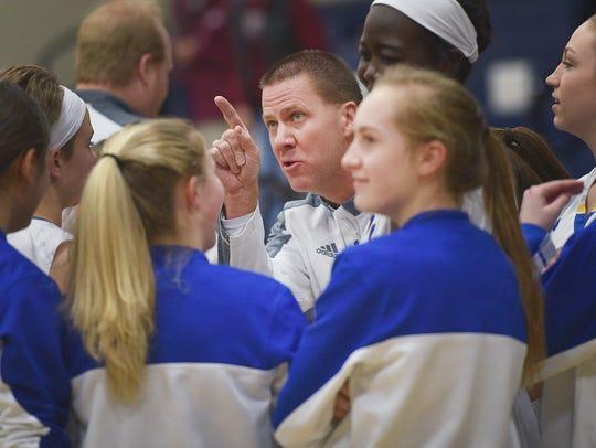 O'Gorman's coach Kent Kolsrud talks to the team before