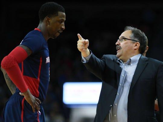 Pistons coach Stan Van Gundy talks to guard Kentavious